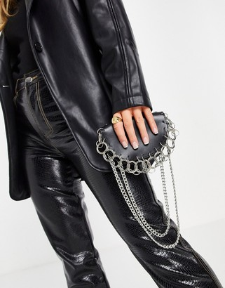Truffle Collection across body bag with ring and chain detail in black