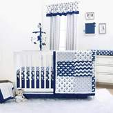 The Peanut Shell Whale 4-Piece Crib Bedding Set in Navy