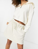 Thumbnail for your product : Weekday Ada organic cotton plant based dye mini pull on skirt in off white