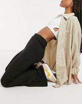 Thumbnail for your product : Monki Wilda jersey flare trousers in black