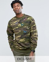 Reclaimed Vintage Oversized Camo Sweatshirt With Butterfly Patches