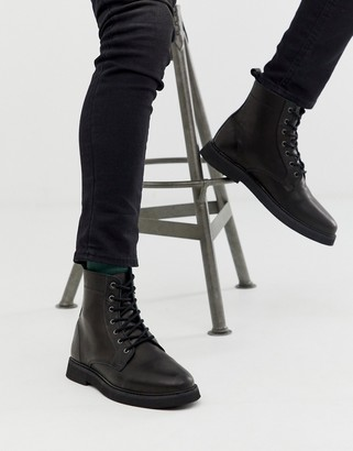 Asos DESIGN lace up boots in black leather with chunky sole