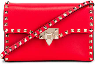 Valentino Rockstud Crossbody Bag in Red | FWRD