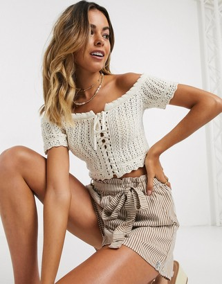 ASOS DESIGN off shoulder top in crochet stitch with lace up detail