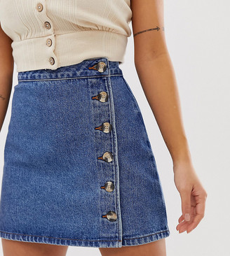 Asos DESIGN Petite denim wrap skirt with buttons in midwash blue