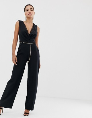 Lipsy jumpsuit with lace insert and chain belt in black