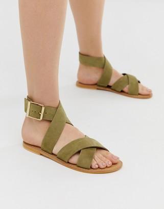 ASOS DESIGN Flossy leather cross strap flat sandals in khaki