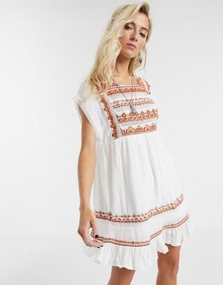 Free People Sunrise Wandaer mini dress in white