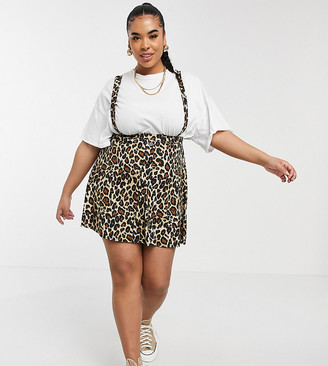 ASOS DESIGN Curve button front mini pinafore skirt in leopard print