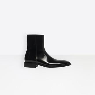 Balenciaga Glazed calfskin zipped boots in black glazed leather