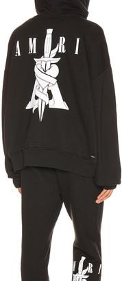 Amiri Dagger Oversized Hoodie in Black | FWRD
