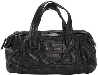 Pierre Hardy Black Patent leather Handbags