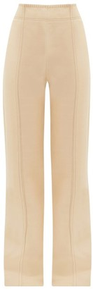 Acne Studios Whipstitched Flared Trousers - Womens - Cream