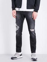 Calvin Klein Slim-fit tapered stretch-denim jeans