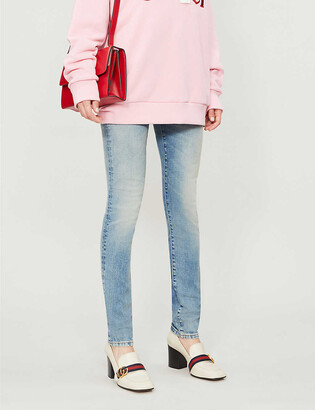 Gucci Patch-embroidered skinny mid-rise jeans