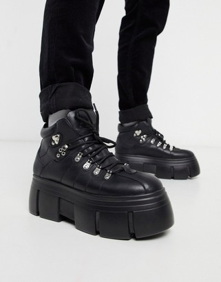 Asos DESIGN lace up boots in black faux leather with chunky sole