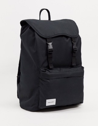 Asos DESIGN backpack in black with white branded patch and double strap