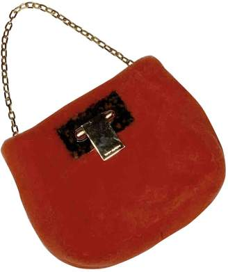 Tory Burch Orange Shearling Handbags