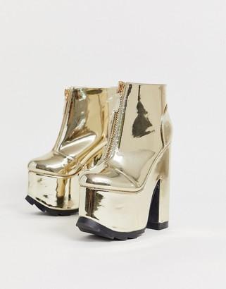 Yru Y-R-U - heeled boots with plateau Soles in gold
