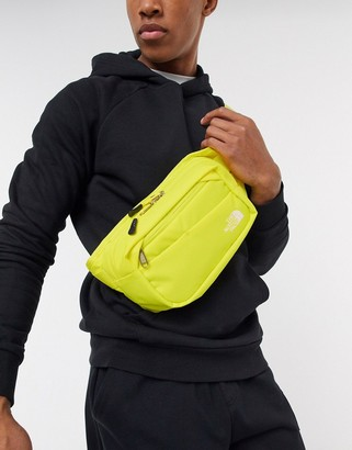 The North Face Bozer II bum bag in yellow