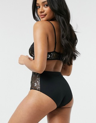 Monki Sissela recycled mesh moon and star print high waist briefs in black