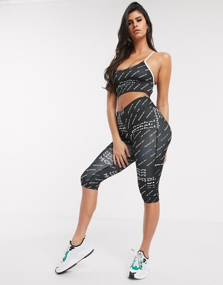 Reebok Training cropped leggings in black with all over logo