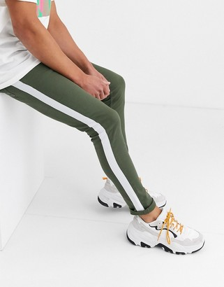 ASOS DESIGN super skinny jeans with side stripe in khaki