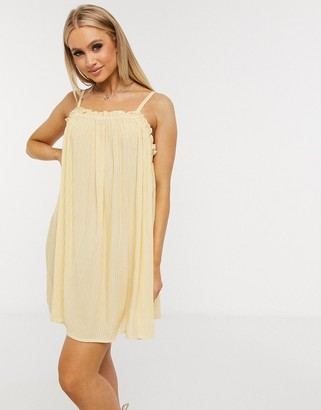 ASOS DESIGN flutter edge beach sundress in fine yellow stripe