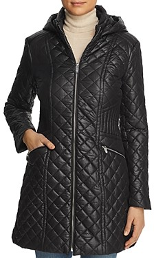 Exact Product: Kendall Jenner Black Oversized Puffer Long Jacket Street Style Autumn Winter 2020, Brand: Via Spiga, Available on: shopstyle.com, Price: $120
