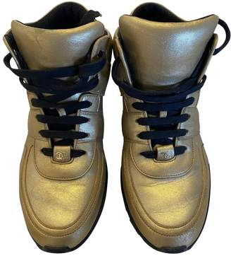 Chanel Gold Leather Trainers