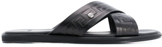Versace embossed Greca crossover strap sandals