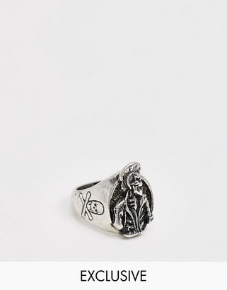 Reclaimed Vintage Inspired punk skeleton ring in silver