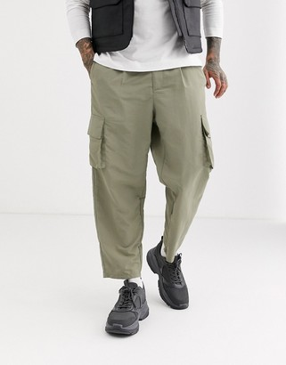Asos DESIGN tapered cargo trousers in nylon