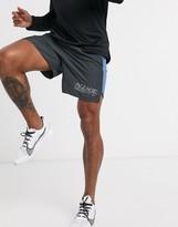 Nike Running Challenger logo shorts in dark gray