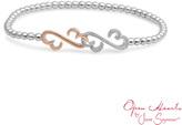 "Zales Open Hearts by Jane SeymourTM 1/10 CT. T.W. Diamond Stretch Bracelet in Sterling Silver and 10K Rose Gold - 7.5"""