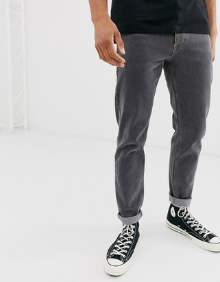 ASOS DESIGN stretch tapered jeans in retro washed black