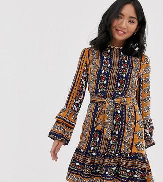 Parisian dress in mix print with self tie belt