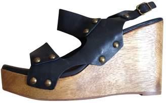 Tila March Black Leather Sandals