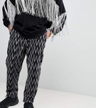Asos Design DESIGN Plus festival tapered trousers in black aztec print