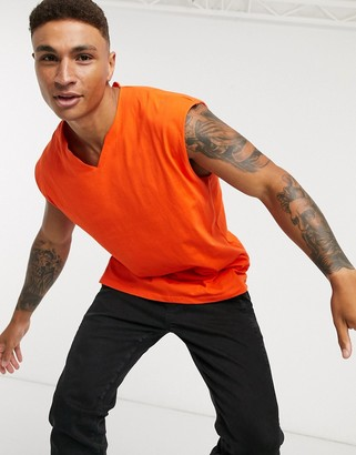 ASOS DESIGN oversized longline sleeveless t-shirt with notch neck in orange