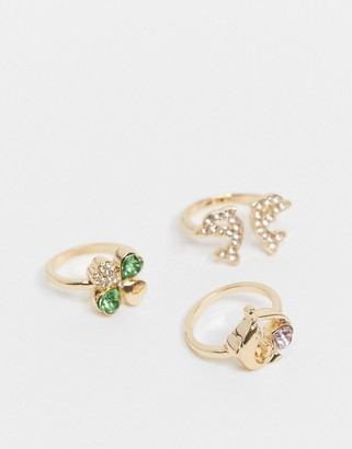 ASOS DESIGN pack of 3 dolphin and clover rings in gold tone
