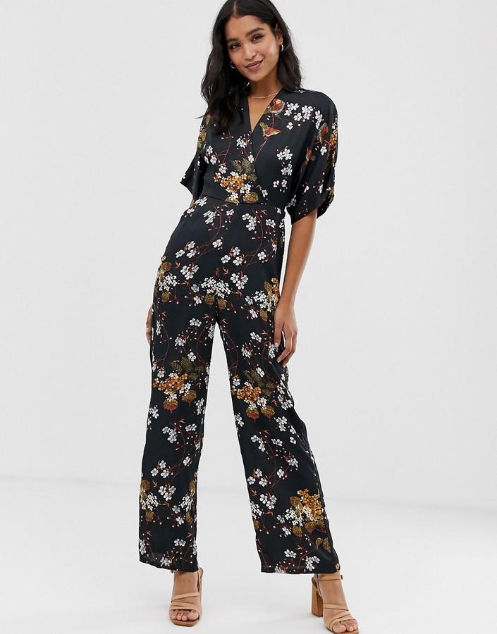 Liquorish wrap front jumpsuit in floral print-Black