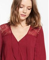 Express lace banded hem surplice blouse