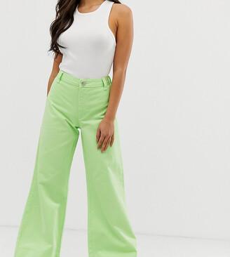 Asos DESIGN Petite full length wide leg jeans in neon pastel green with deep hem detail