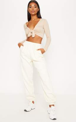 PrettyLittleThing Stone Long Sleeve Tie Front Crop Top