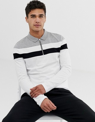 Asos Design DESIGN long sleeve polo shirt with zip neck and body and sleeve colour block in white