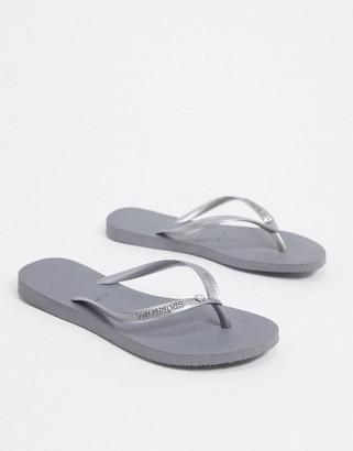Havaianas slim crystal flip flops in gray