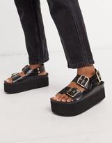 Felina Genuins footbed sandals in black croc