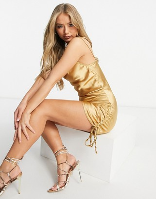 Femme Luxe satin ruched tie side detail mini dress in gold