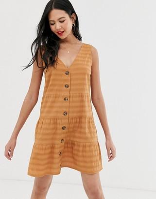 Asos Design DESIGN sleeveless button through tiered smock mini dress-Brown